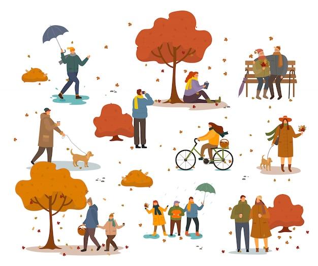 秋の黄金公園で歩いたり座ったりする人々