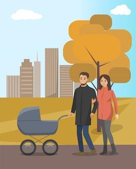 Осенний парк и пара гуляют с коляской