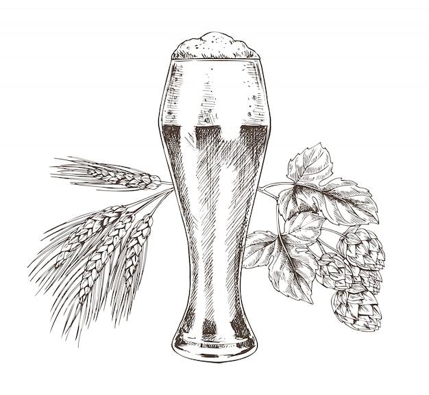 ホップと小麦のスタックと泡沫アルコールビールグラス