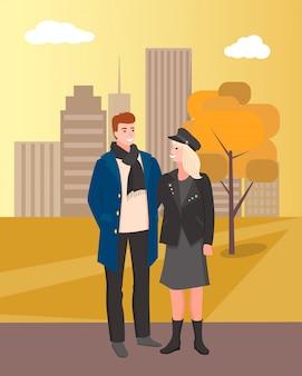秋の公園都市を歩いて男と女のカップル
