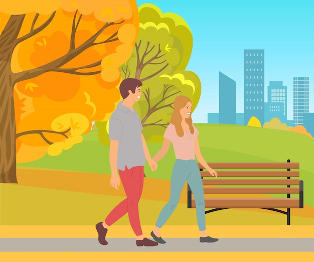 Пара гуляет, держась за руки, мужчина и женщина парк