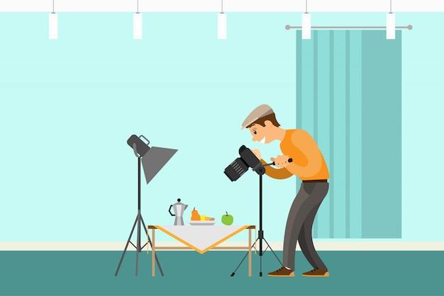 静物画のショットを作る写真家