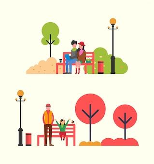 赤いベンチで時間を過ごす秋の人々