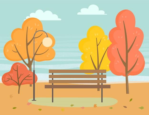 秋の公園、木の近くの木製のベンチの風景