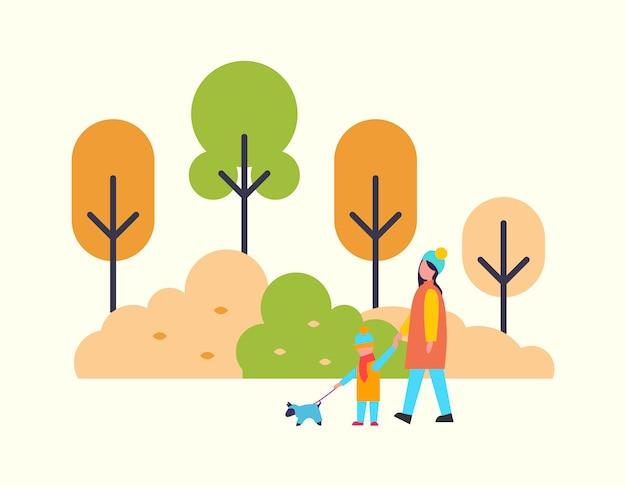 子供とかわいいペットの犬を屋外で歩く女性