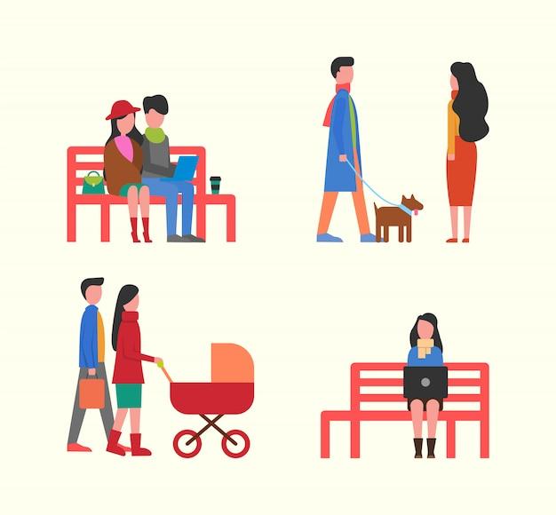 ベンチ、家族の散歩にラップトップに取り組んでいるカップル