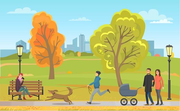 秋の公園で飼い主と家族と一緒にペット