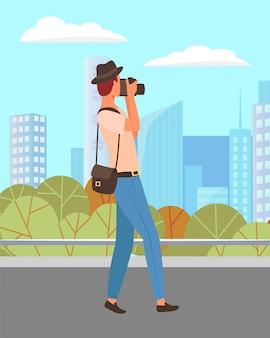 都市公園の風景を撮影するカメラマン