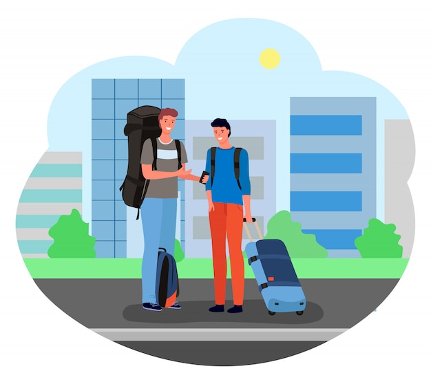 スーツケースと荷物を持って立っている男性の観光客