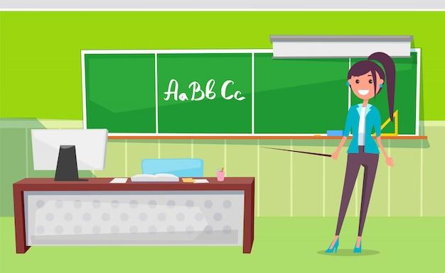 文字と黒板の近くに立っている先生