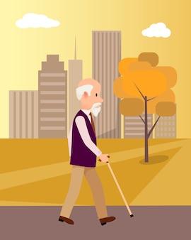 都市公園の図に杖を持つシニア男
