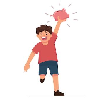 幸せな子供は彼の貯金を見せる