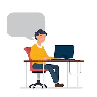 コンピューターの前に座っている若い男