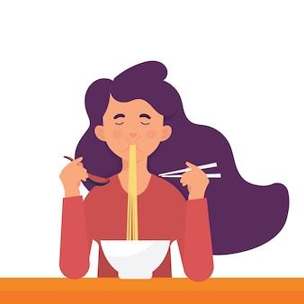 若い女性がラーメンを食べる