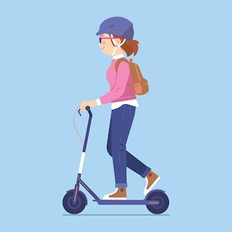 キックスクーターに乗って若い女性、