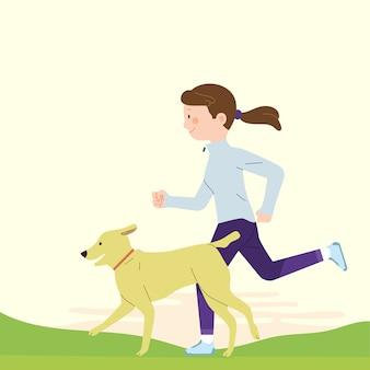 公園で彼女の犬と一緒に走っている女性