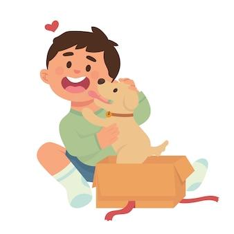 男の子は贈り物としてかわいい子犬を得ます