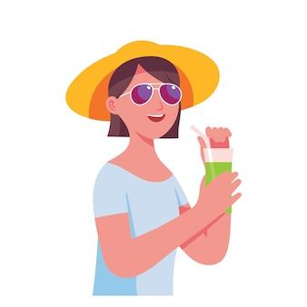若い女性は休暇中に新鮮なジュースを飲む