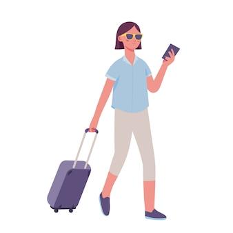 Молодая женщина тянет чемодан и держит паспорт, готовясь к праздникам
