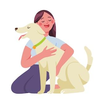 Молодая женщина ласково обнимает свою собаку