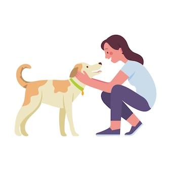 若い女性が彼女の最愛の犬をなでる