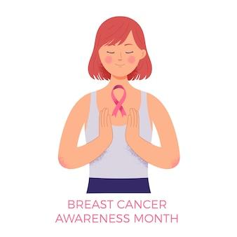 乳がん啓発月間のシンボルとしてピンクのリボンを保持している女性