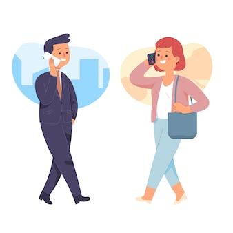 働く男性と女性が携帯電話を押しながら歩きながら話す