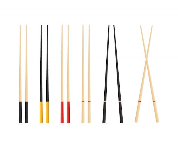 寿司ロールを保持している箸。スナック、寿司、エキゾチックな栄養、寿司レストランの概念。