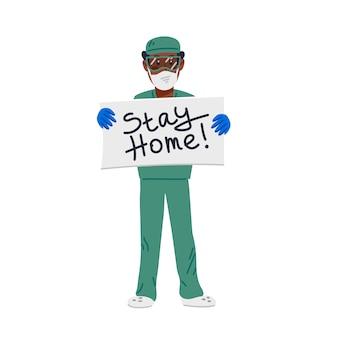 滞在ホームの碑文とサインを保持している緑のスクラブで疲れたアフリカ系アメリカ人の医者