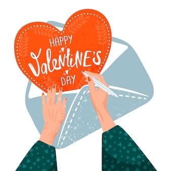 バレンタインのグリーティングカード。バレンタインカードを作る女性。