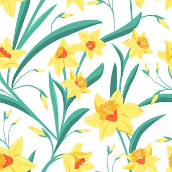 緑の葉と黄色い水仙のシームレスパターン