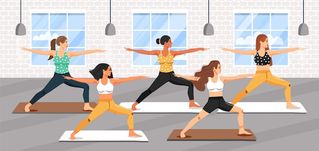 Группа молодых спортивных женщин, практикующих урок йоги