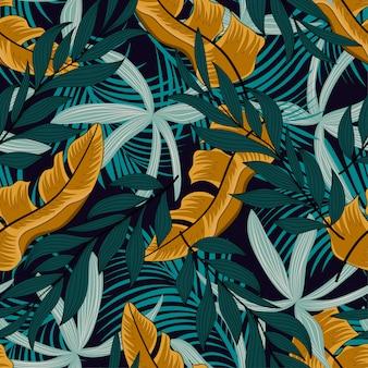 緑と黄色の植物とのシームレスな熱帯パターン。モダン