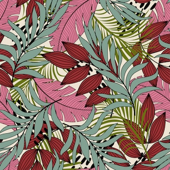 Абстрактный тропический бесшовный узор с разноцветными листьями и растениями и красивым фоном