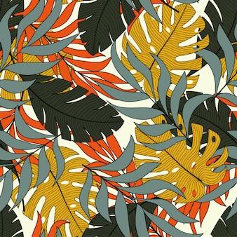 Модный тропический бесшовный фон с ярко-оранжевыми и желтыми листьями и растениями