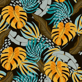 美しい黄色と青の葉と植物の夏のシームレスな熱帯パターン