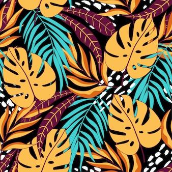Бесшовные тропический узор с красивыми желтыми и синими листьями и растениями