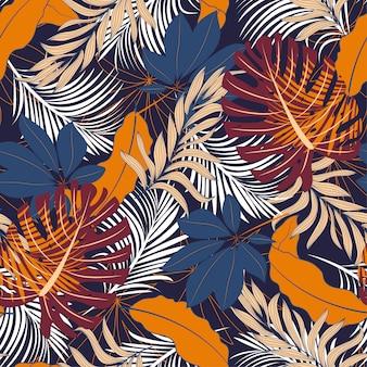 明るい赤と青の植物と葉を持つ抽象的なシームレスな熱帯パターン