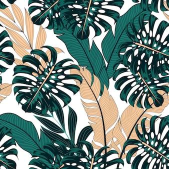 カラフルな植物と葉を持つファッショナブルなシームレスな熱帯パターン