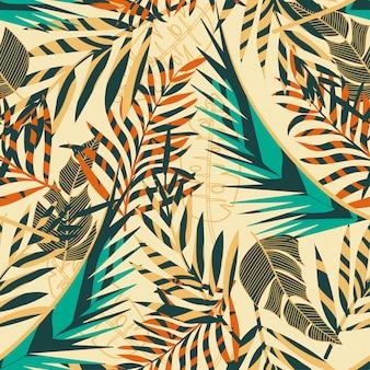 夏のトレンドの明るい熱帯の葉と植物のシームレス背景