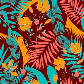 Модный бесшовный узор с разноцветными тропическими листьями и цветами