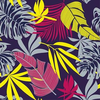 カラフルな熱帯の葉と花のトレンディなシームレスパターン