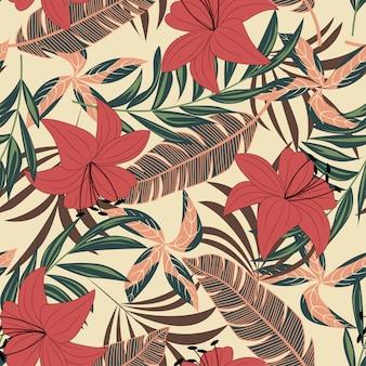Оригинальный бесшовный узор с разноцветными тропическими листьями и цветами