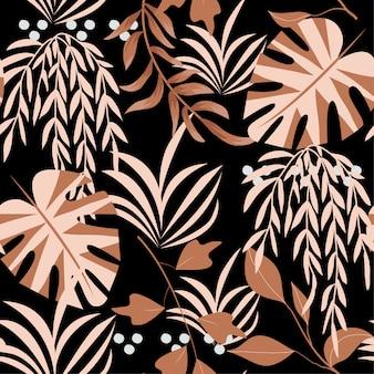 Летний яркий бесшовный узор с разноцветными тропическими листьями и растениями на черном фоне