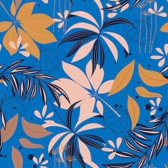 カラフルな熱帯の葉と青い背景上の植物で夏の明るいシームレスパターン