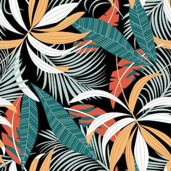 色鮮やかな葉と植物の熱帯のシームレスパターン