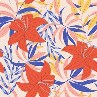 Тенденция яркий бесшовный фон с разноцветными тропическими листьями и растениями