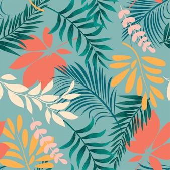 カラフルな熱帯の葉と植物の抽象的な明るいシームレスパターン