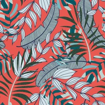 カラフルな熱帯の葉と赤の植物で抽象的な明るいシームレスパターン