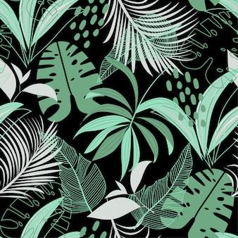 カラフルな熱帯の葉と黒の植物でトレンドのシームレスパターン
